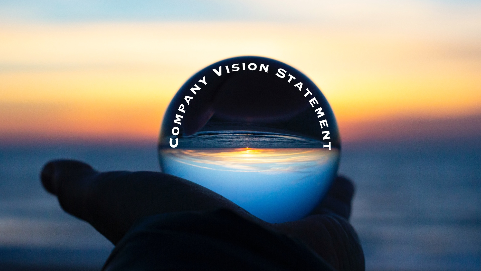 Hand with Crystal Ball with Words - Company Vision Statement Examples
